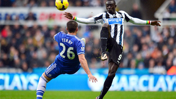Chelsea's-John-Terry-(left)-and-Newcastle-United's-Papiss-Cisse-battle-for-the-ball
